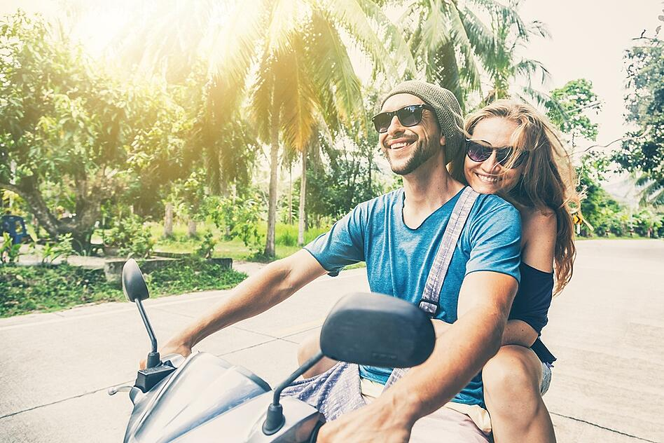 couple on a motorbike during their honeymoon